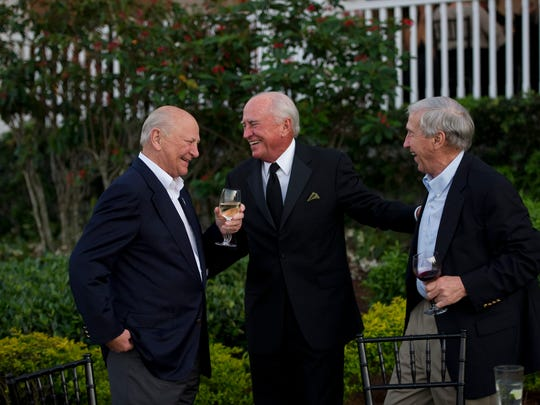 Wayne Huizenga (left) shares a moment with friend Lee Moffitt and cousin Peter Huizenga during the Palm City 100th Anniversary Celebration at The Floridian in March 2012.
