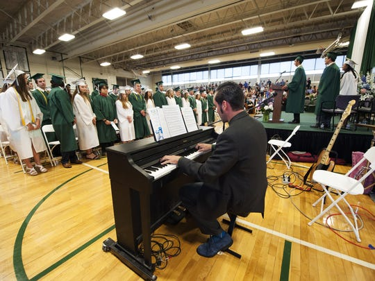 Brian Lynam plays the piano as the graduates take their seats in the gym during the Rice Memorial High School graduation ceremony at Rice on Sunday June 7, 2015 in South Burlington. (BRIAN JENKINS/for the FREE PRESS)