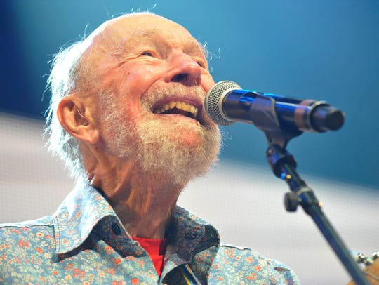 Pete Seeger, shown performing at the Farm Aid 2013 concert in Saratoga Springs. The singer and activist from the Hudson Valley would have celebrated his 100th birthday May 3.