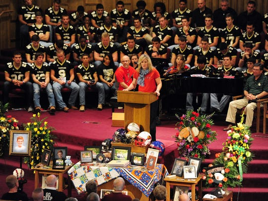 Pioneer Drive Baptist Church Children's Minister Kimberely McMillon talks about the bright personality of Rex Fleming during a memorial service for the 10-year-old on Friday, November 30, 2012, at Pioneer Drive Baptist Church. The Abilene High School football team was a favorite team of Rex's, they sat in the choir section during the memorial.