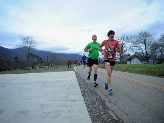 Participants in the 2018 Black Mountain Greenway Challenge 5K/10K make their way along Tabernacle Road as they head toward Cragmont Road.