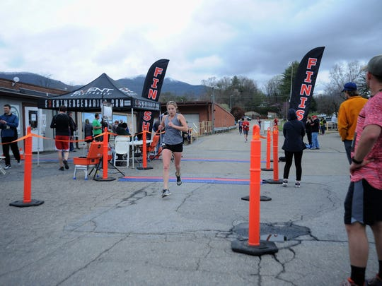 Runners finish the 2018 Black Mountain Greenway Challenge in front of Pisgah Brewing Co. in 2018. The race returns for its 12th year on April 6.