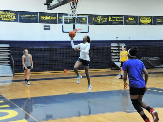 ACA senior MaLeeah Langstaff, who committed to play NCAA Division I basketball at Winthrop University next fall, practices with Team Carolina on April 12.