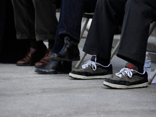 Tom Mauser, father of slain student Daniel Mauser, wears his son's shoes at the Columbine Remembrance and Rededication to mark the 10th anniversary of the Columbine school shooting at the Capitol in Denver, Colo., on Monday, April 20, 2009.
