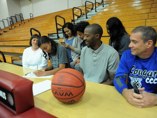 Surrounded by family, Owen senior Dee Graves signs