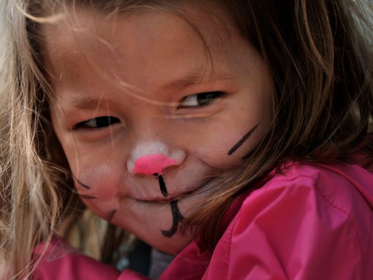 Micah Favor, 4, shows off her facepaint at the Adamson-Spalding Storybook Garden on Saturday, billed as the Big Day Downtown in Abilene.