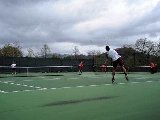 Junior Lorenz Hoover elevates as he delivers a serve