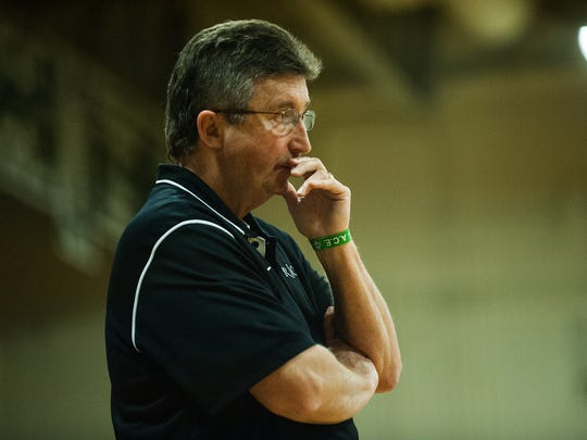 Rice head coach Tim Rice watches the action on the