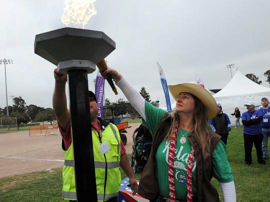 Tonya Linares lit the torch for Friday's opening ceremony of the 21st annual Salinas Relay for Life at the Salinas Sports Complex to raise awareness about cancer and advocacy for a cure.