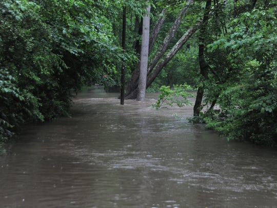 The Flat Creek Greenway is submerged after heavy rains caused Flat Creek to swell and breach its banks on May 29. Several nearby residents were evacuated.