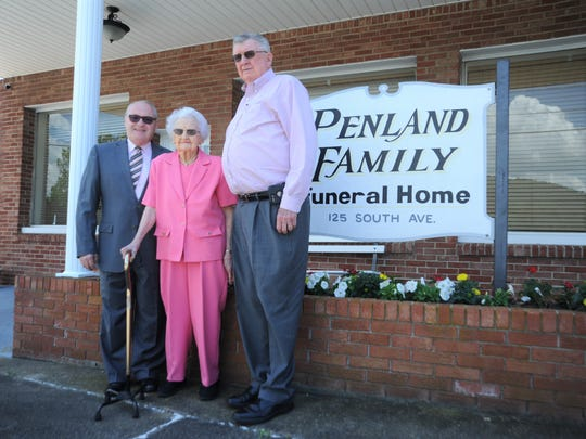 "Ruth Penland stands in front of Penland Family Funeral Home in Swannanoa with her son Jim, right, and manager Charles Graves, who Ruth calls her ""adopted son."" Ruth Penland turns 100 on June 19."
