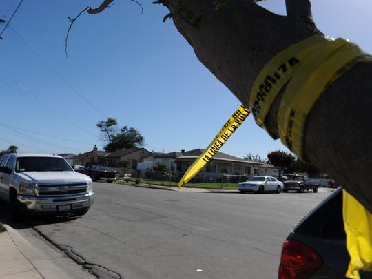 Police tape remains on a tree along Center Street where