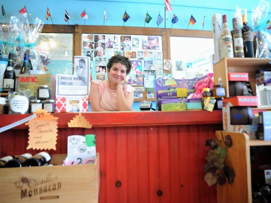 Martha Speegle-Snell, an employee of The Merry Wine Market in Black Mountain, was ready for a busy June 16 - Dine & Shop Day, in which business donated a portion of sales to Black Mountain Home for Children.