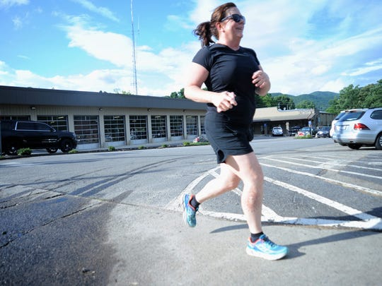 Donna Gray runs on a Wednesday evening in Black Mountain as she prepares for her first 5k, which will be at the Gateway 5K in Old Fort in August.