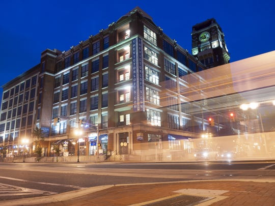 A NJ Transit River Line train passes by the Victor building in Camden in this 2014 photograph shot with a long exposure.