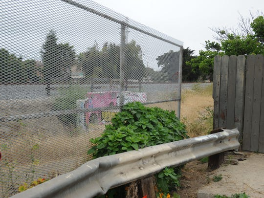 Pedestrians often use the opening in this fence along Anacapa Street and Ocean Avenue to access Vista Del Mar Drive in Ventura.