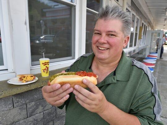 Hot Dog expert John Fox poses at the Galloping Hill