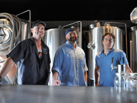 "John Richardson, left, Jeff ""Puff"" Irvin, middle, and Matt Schwarz are opening Black Mountain Brewing on Broadway Avenue in the coming weeks."