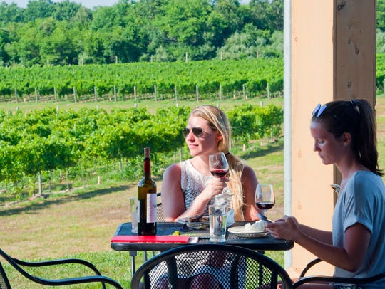 Guests enjoy the new outdoor patio at Sharrott Winery