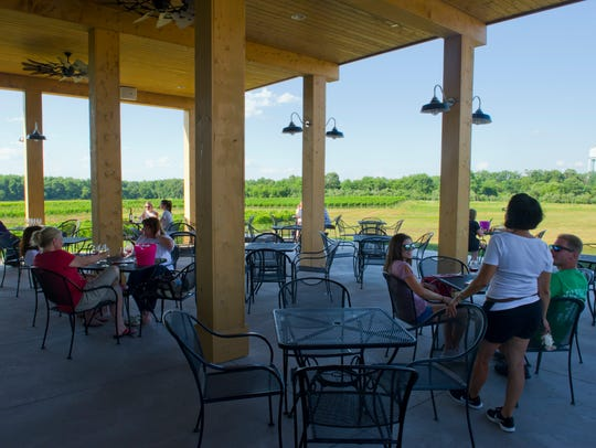 Guests enjoy a three-season patio at Sharrott Winery.