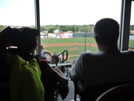 Scott Gaalswyk, right, watches the Sioux Falls Canaries