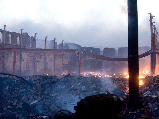 This 2011 file photograph shows the massive fire at an abandoned tire warehouse. Seven years later, the lot is vacant and trash is often illegally dumped here, residents say.
