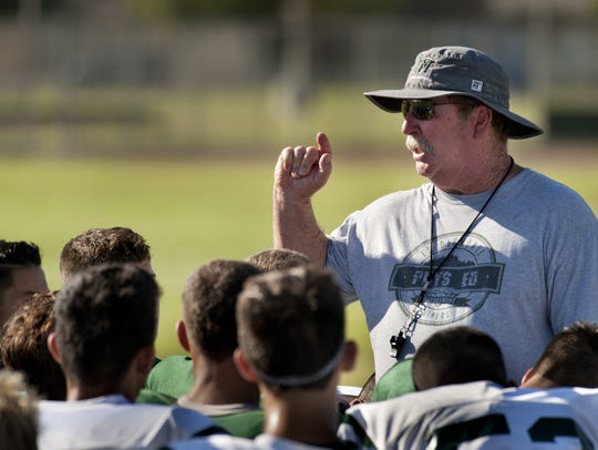 El Diamante football coach Mark Rogers talks with the