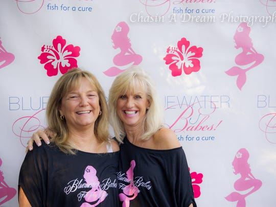 Kathy Black, at left, enjoys a past Fish For A Cure