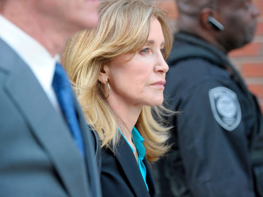 TOPSHOT - Actress Felicity Huffman exits the courthouse