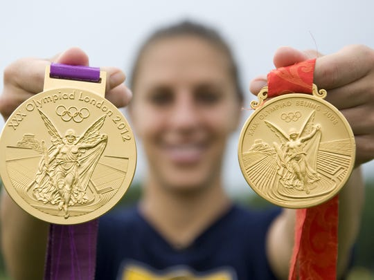 U.S. soccer star and Delran native Carli Lloyd shows off her gold medals from London and Beijing Tuesday at the Universal Soccer Academy in Lumberton.