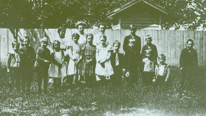 This 1897 photo shows teacher Mary Dwyer with her students at their school on Woodman Road (now Culver Road) in Irondequoit.