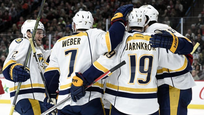 Predators Anthony Bitetto (2), Yannick Weber (7) and Calle Jarnkrok (19) congratulate right wing James Neal (18) on scoring against the Wild during the second period Sunday, Jan. 22, 2017.