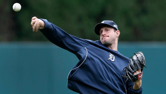 Detroit Tigers pitcher Max Scherzer throws during baseball practice in Detroit Tuesday, Sept. 30, 2014. The Detroit Tigers start the playoffs at the Baltimore Orioles in Game 1 of the American League Division Series Thursday.