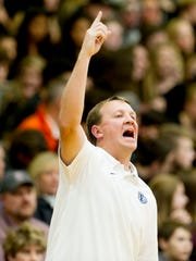 Farragut's Head Coach Jason Mayfield calls from the bench during a basketball game between Farragut and Bearden at Farragut High School in Farragut, Tennessee on Friday, December 8, 2017.