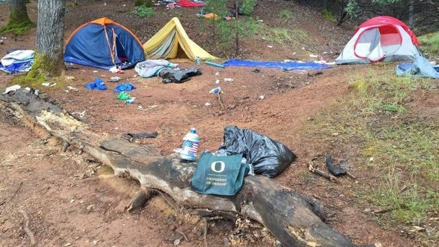University of Oregon paraphernalia, tents and other items were left behind on Slaughterhouse Island in Lake Shasta over a weekend in May 2016.