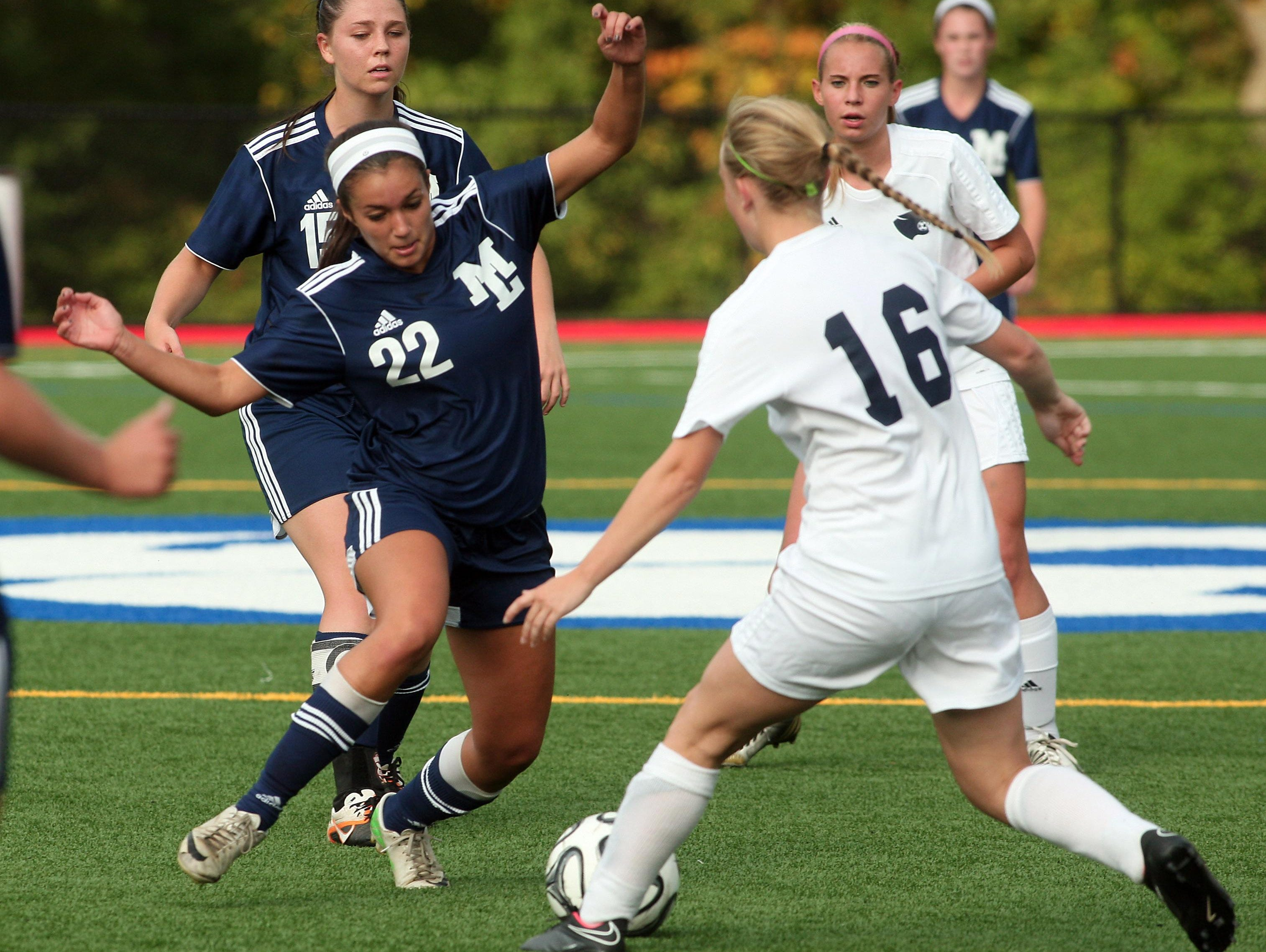 Mountain Lakes' Emee Fernandez (22) and Chatham's Grace Larson (16) battle for the ball on Sept. 30, 2014.