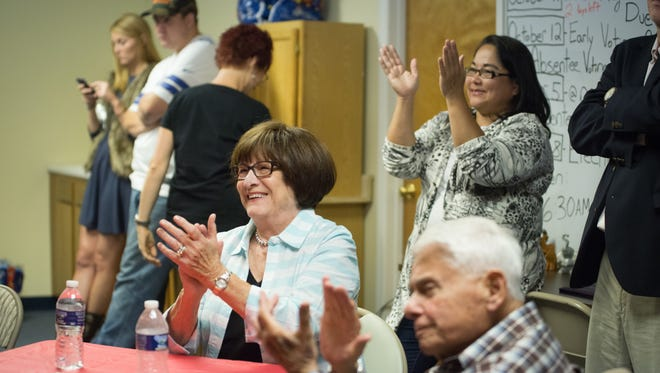 Betty Dubin, center, and her husband, Malcolm, applaud Donald Trump during the second 2016 presidential candidate debate Sunday October 9, 2016.