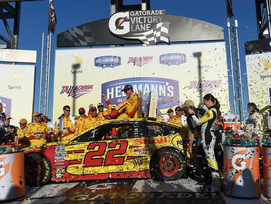 Joey Logano celebrates after winning the NASCAR Sprint Cup Series auto race auto race at Talladega Superspeedway, Sunday, Oct. 23, 2016, in Talladega, Ala. (AP Photo/Rainier Ehrhardt)