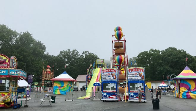 Dreamland Amusements sets up across from the clubhouse in White Meadow Lake on July 14 for Festival Days in spite of the rain.