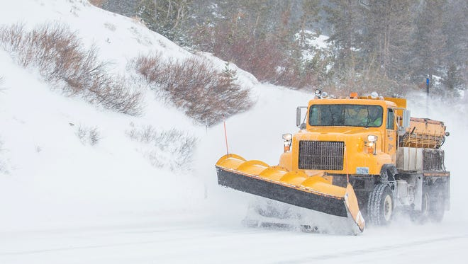 A snow plow works near the summit of the Mt. Rose Highway on Monday, February 26, 2018.