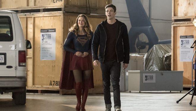 Melissa Benoist as Kara/Supergirl and Grant Gustin as Barry Allen in CW's superhero crossover event this week.
