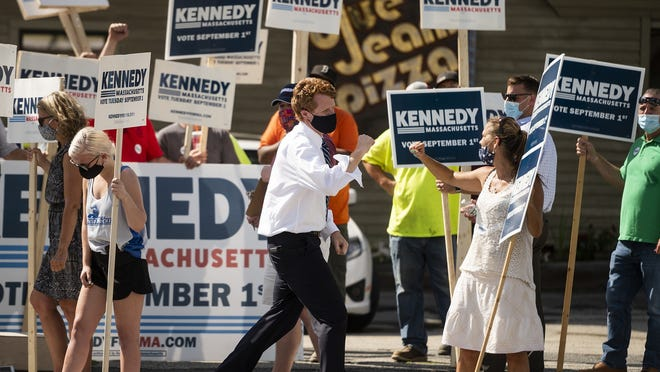 U.S. Rep. Joe Kennedy III thanks supporters as they stand with signs at Park Avenue and Pleasant Street in Worcester on Wednesday.