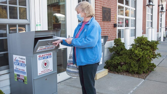 Voter Sandy Congdon drops her election ballot in the newly installed drop-off box outside the Franklin Street fire station in Worcester on Friday.