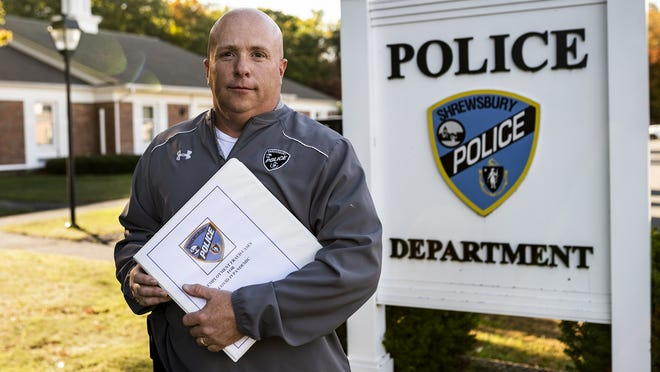 Shrewsbury Police Detective Paul Brown holds a binder with more than 300 identity theft reports from local residents. The reports consist of people whose personal  information has been used to collect or attempt to collect unemployment insurance benefits in local residents' names.