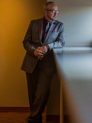 Joe Mulshenock wears a Marc Anthony taupe wool sport