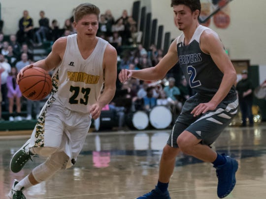 Pennfield's Grant Peterson (23) drives to the basket during first half action Friday evening.