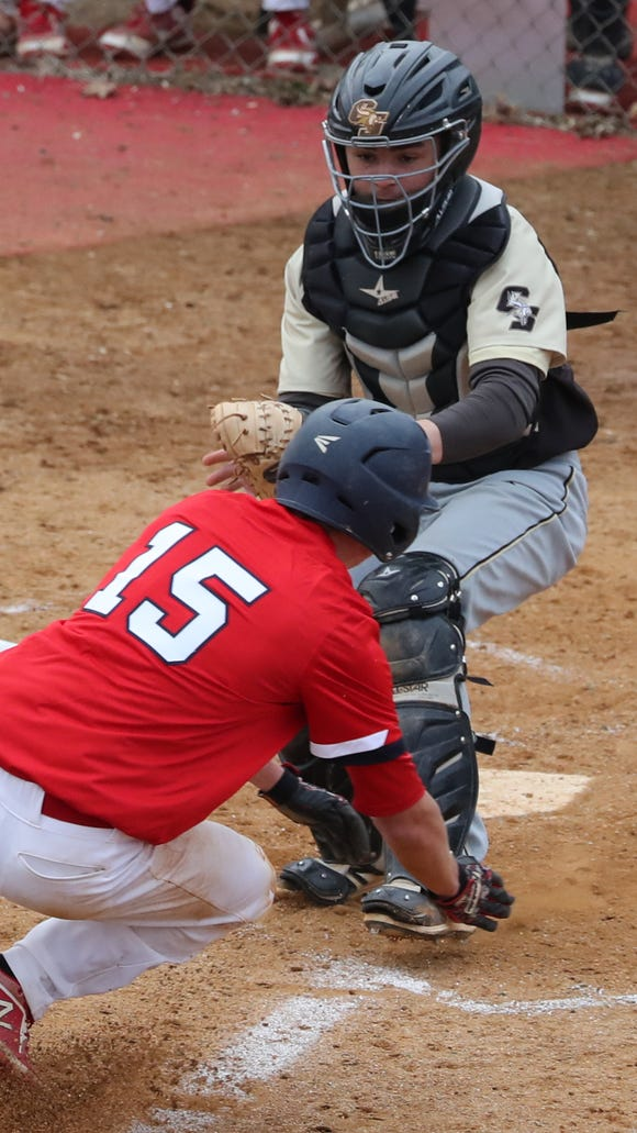 RC Ketcham's Bryce Mordecki is tagged out by Clarkstown