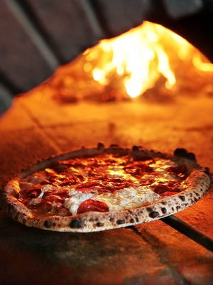 Pizza in the ovens at the original Hog & Hominy.
