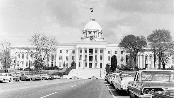 View of the Alabama State Capitol, which flies Confederate and Alabama flags, on the day before the Selma to Montgomery March arrived, Montgomery, Alabama, March 24, 1965.