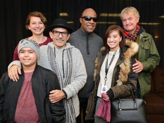 Stevie Wonder (center) meets with Rocco Schwartz, Sarah Clayman, Bedrock's Bruce Schwartz, Jena Irene and Kevin Nixon at Joe Louis Arena on Nov. 21.